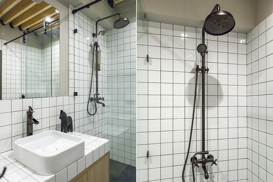 7-1-minimalist-style-bathroom-interior-design-concrete-wall-texture-white-square-tiles-black-accents-sanitary-fixtures-water-tap-horse-tropical-shower-head-retro