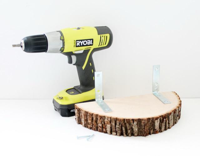 8-2-tree-wood-cross-sections-cuts-DIY-book-shelf-handmade-decor-wall-mounted-angle-brackets-drill