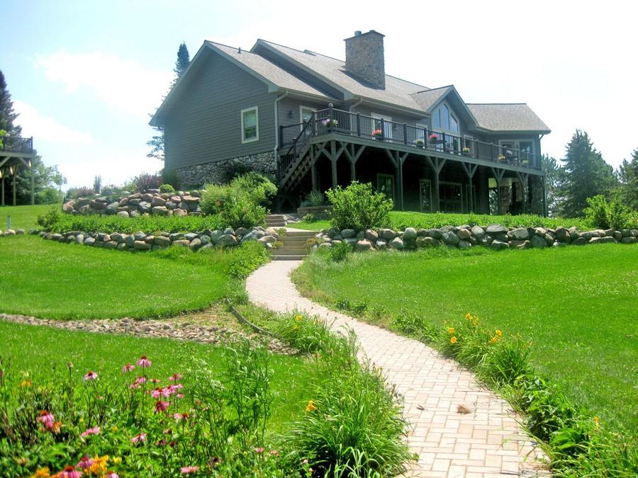 9-garden-path-design-landscape-walkway-winding-yard-big-house-rocks-stones-flowers-lawn-sloped-terrain