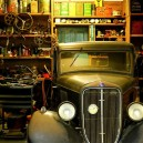 0-cluttured-garage-retro-car-open-racks