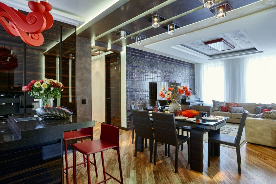 0-contemporary-style-interior-design-open-concept-living-dining-room-dark-chocolate-brown-wooden-furniture-light-beige-sofa-floor-red-accents-bar-stools-TV-set-hand-made-wall-tiles-by-Franco-Pesshioli-collection