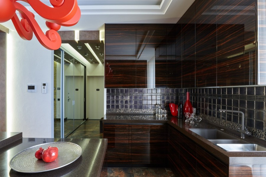 1-2-contemporary-style-interior-design-kitchen-dark-chocolate-brown-wooden-cabinets-wood-grain-polished-red-accents-hand-made-wall-tiles-by-Franco-Pesshioli-collection-backsplash-lamp