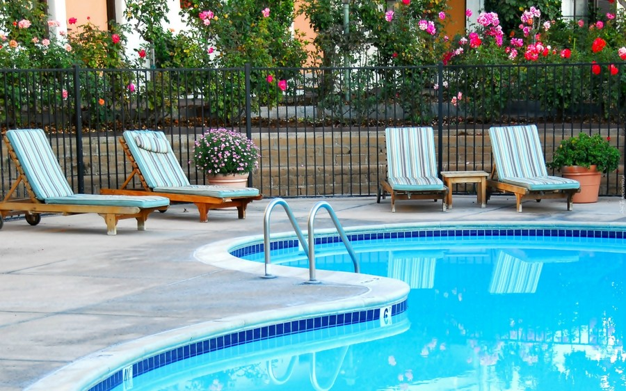 1-outdoor-swimming-pool-stripy-blue-chaise-lounges-wooden