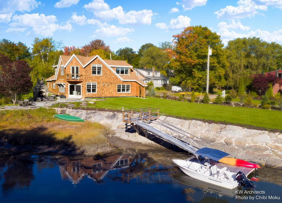 1-traditional-style-house-shingled-roof-cape-cod-house-on-the-Kennebunk-river-bank-American-New-England-wharf-boat-forest-lawn