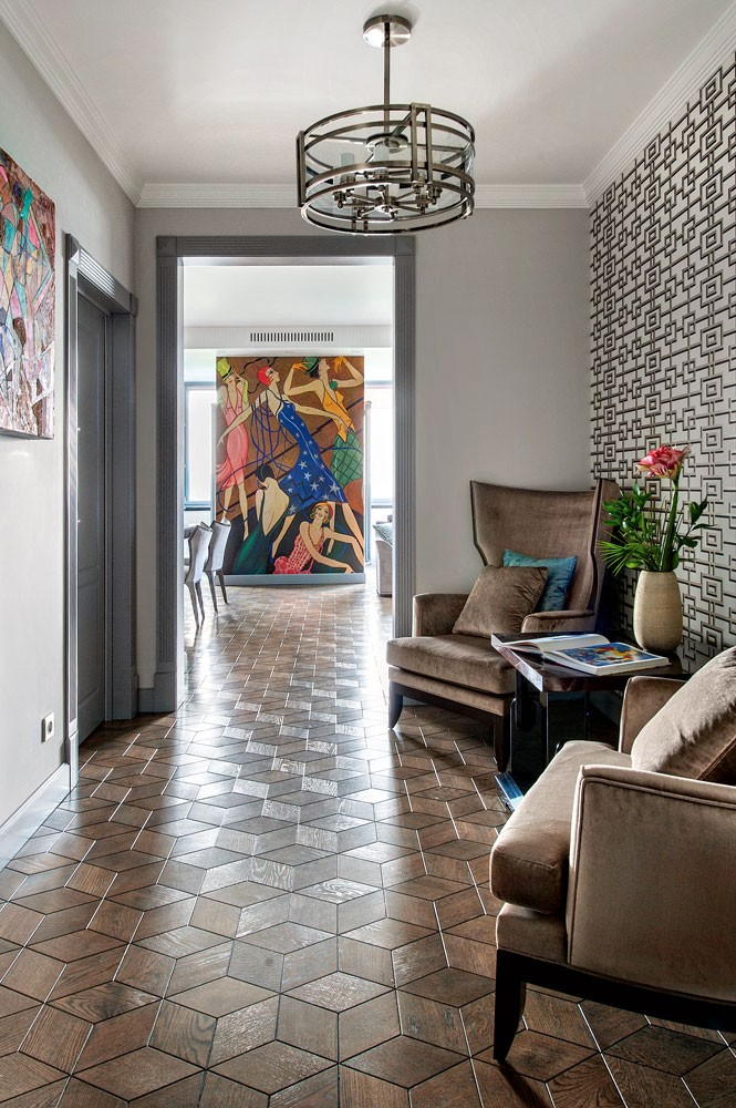 10-corridor-interior-design-hallway-in-art-deco-style-symmetrical-arm-chairs-coffee-table-geometrical-nabucco-collection-wallpaper-by-designers-guild-block-parquetry-metal-chandelier-wall-art-artwork-mural