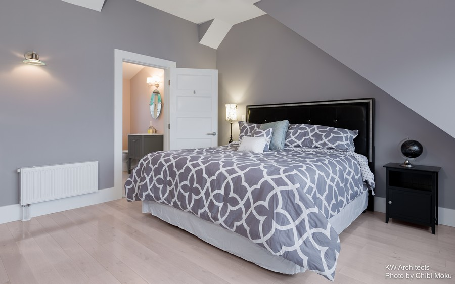 11-contemporary-style-interior-design-gray-white-blue-bedroom-geometrical-bedspread-bed-cover-sloped-ceiling-black-nightstand-leather-upholstered-headboard