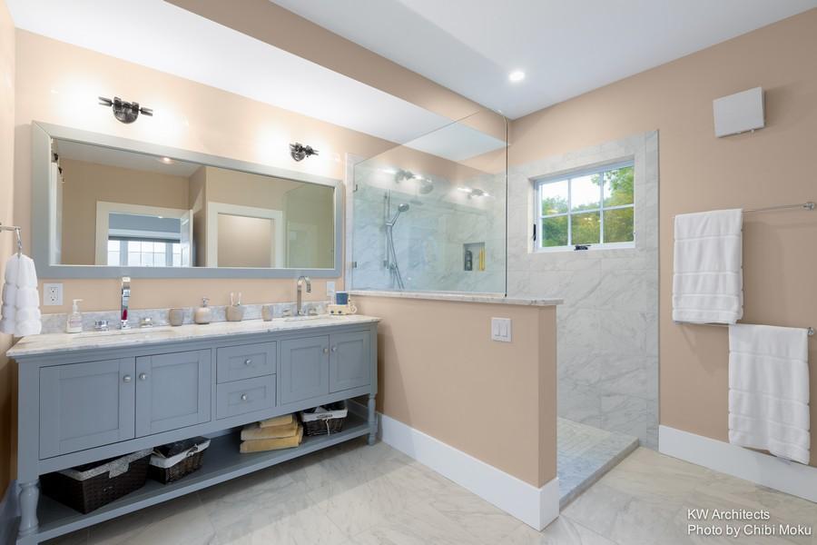 12-contemporary-style-interior-design-bathroom-white-marble-wall-tiles-walk-in-shower-cabin-gray-vanity-unit-big-double-wash-basin-cabinet-mirror-towel-rails