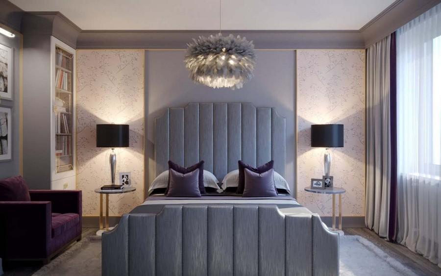 2-1-contemporary-style-bedroom-interior-design-beige-and-gray-Eichholtz-furniture-upholstered-bed-tall-headboard-black-bedside-lamps-tables-chandelier-reading-area-glass-bookcase-arm-chair-rug-purple-accents