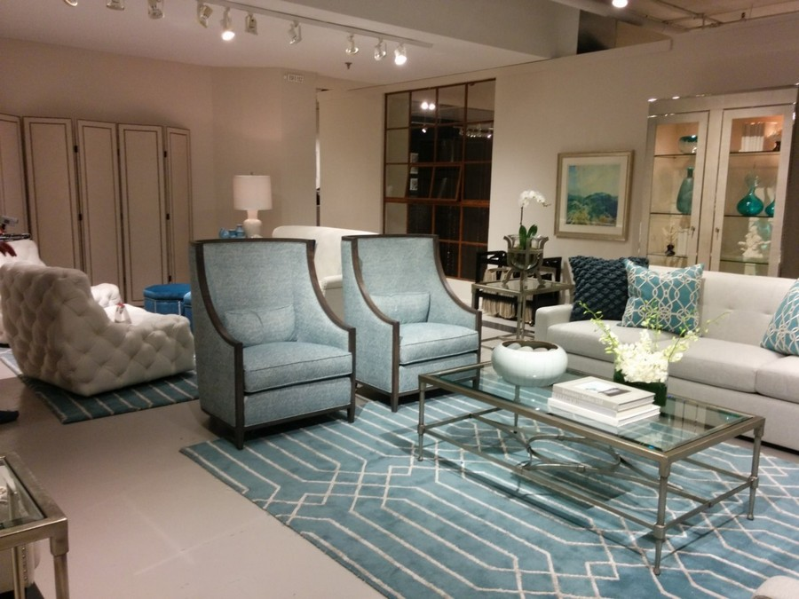 2-3-American-style-furniture-collection-2017-in-interior-design-High-Point-Market-Fair-Spring-2017-beige-sofa-blue-rug-white-geometrical-pattern-blue-arm-chairs-with-wooden-finishes-glass-coffee-table-living-room-set-suite