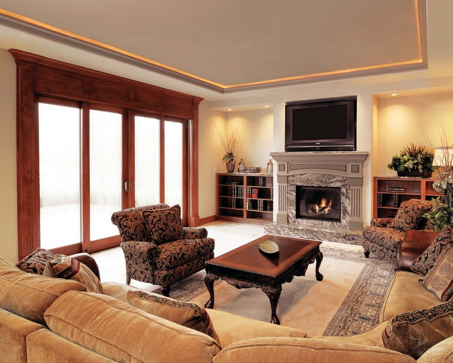 2-beige-and-brown-classical-style-traditional-living-room-interior-design-warm-soft-colors-ceiling-recessed-LED-lights-along-perimeter-TV-set-fireplace-carpet-wooden-coffee-table-big-soft-sofa-panoramic-window-terrace