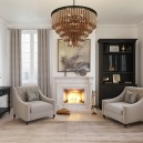 2-gray-beige-dark-brown-bedroom-interior-design-in-American-transitional-style-natural-stone-fireplace-surrounding-two-arm-chairs-bookcase-bookstand-console-table-with-drawers-multilayered-chandelier-rug-artwork
