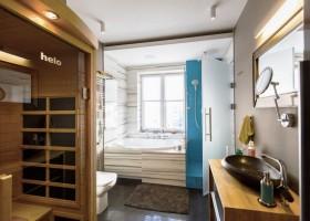 2-modern-bathroom-interior-design-with-walk-in-infrared-home-sauna-white-faux-marble-wall-tiles-acrylic-drop-shaped-bathtub-shower-cabin-azure-blue-tiles-wooden-countertop-black-natural-basalt-sink-wash-basin-mirror-rug