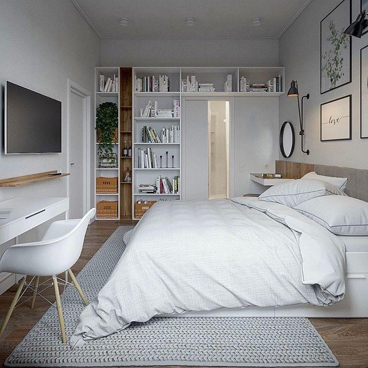 3-bedroom-interior-design-white-gray-Scandinavian-style-minimalistic-desk-chair-oval-mirror-dressing-table-bookshelves-around-the-door-art-wall-TV-set-laconic