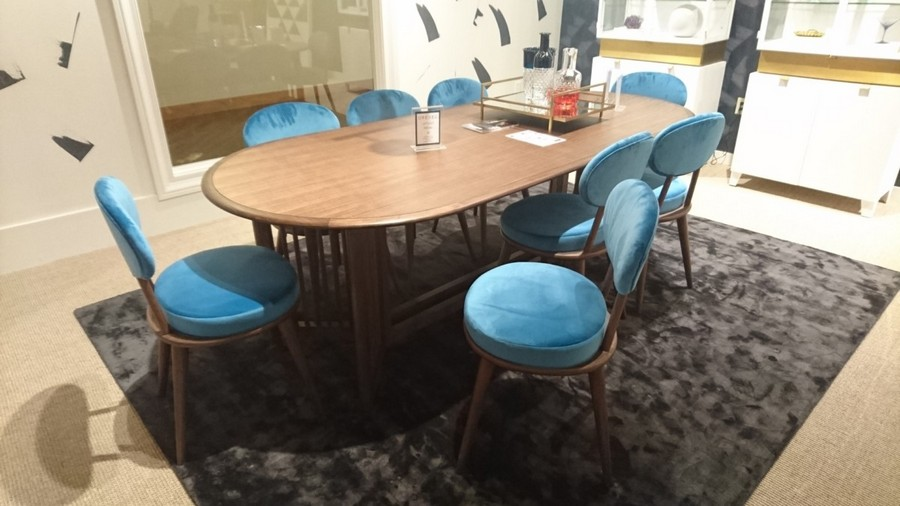4-3-American-style-furniture-collection-2017-in-interior-design-High-Point-Market-Fair-Spring-2017-velvety-rug-dining-room-suite-set-oval-wooden-table-blue-upholstered-chairs-velvety-cushions