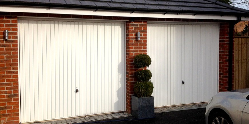 4-up-and-over-garage-doors-white-two-parking-spaces-places-car