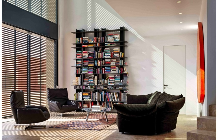 5-7-Edra-new-collection-of-contemporary-style-furniture-at-Salone-de-Mobile-Exhibition-Milan-2017-living-room-interior-design-Venetial-blinds-rug-big-windows-dark-arm-chairs-sofa-bookstand-bookshelves