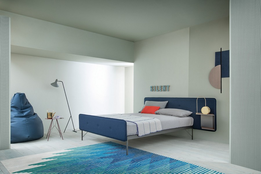 6-7-Zanotta-new-collection-of-contemporary-style-furniture-at-Salone-de-Mobile-Exhibition-Milan-2017-blue-and-gray-bedroom-interior-design-upholstered-bed-bean-bag-chair-floor-lamp-rug-extended-asymmetrical-headboard