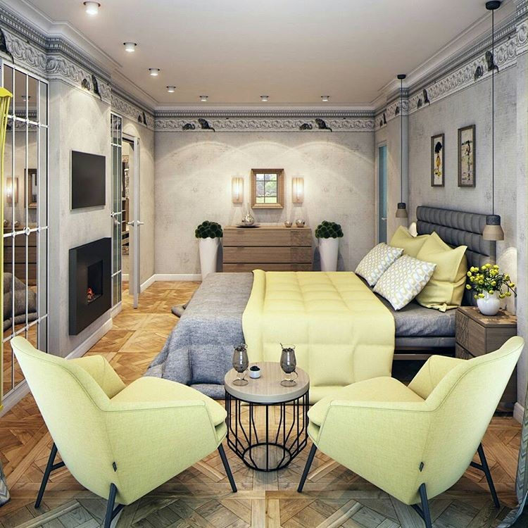 8-4-bedroom-interior-design-contemporary-style-gray-and-pale-yellow-upholstered-bed-headboard-fireplace-TV-set-opposite-bed-mirror-wall-panels-classical-crown-moldings-light-modular-parquet-coffee-table-arm-chairs