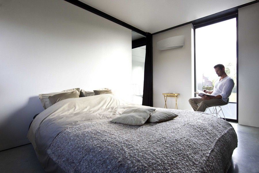 0-air-conditioner-in-the-bedroom-interior-design-minimalist-style-white-walls-big-window-black-curtains