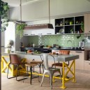 1-4-1-1-open-concept-living-room-dining-area-kitchen-interior-design-Taiwan-island-bar-table-mismatchen-stools-chairs-yellow-legs-pastel-green-backsplash-clinker-wall-tiles-loft-style-motifs