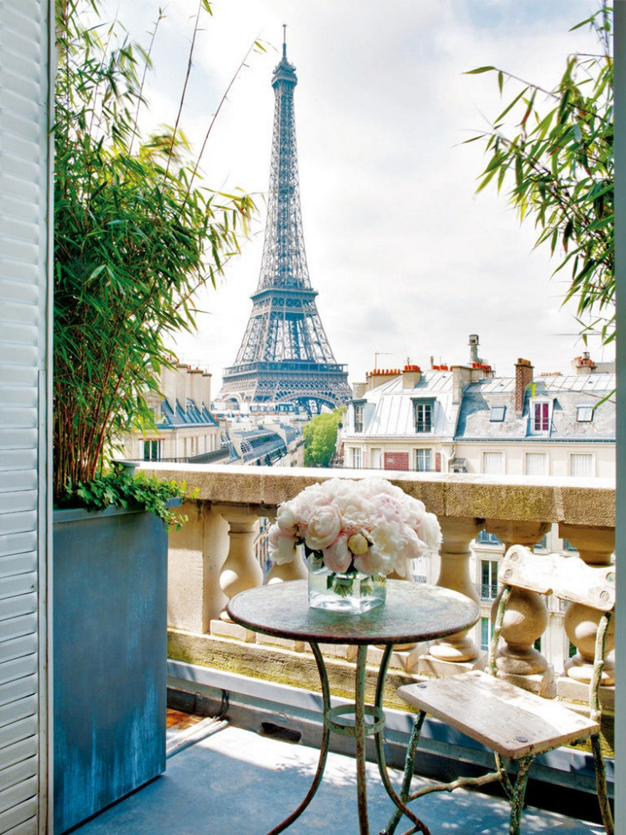 1-Paris-balcony-interior-design-by-Stephane-Olivier-vintage-coffee-table-wooden-chair-flowers-bouquet-marble-floor-the-Eiffel-Tower-view-panorama