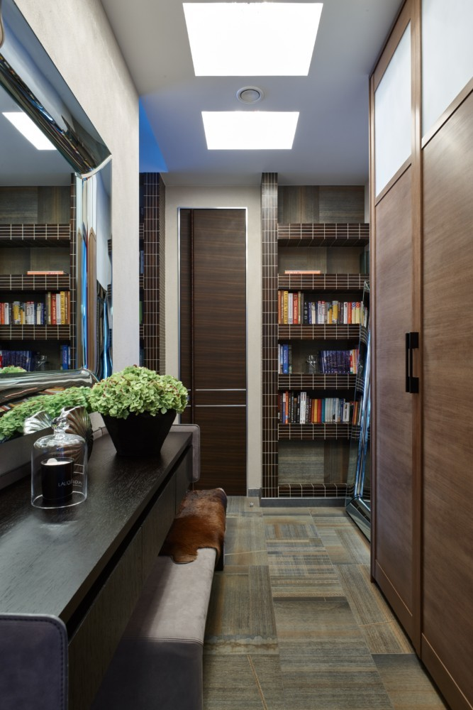 1-contemporary-style-interior-design-faux-wood-floor-tiles-brown-wenge-tiles-bookstand-book-shelves-darwk-wood-console-table-big-metal-frame-mirror-closet-entry-hallway-entrance-hall-bench