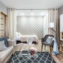1-contemporary-style-interior-design-living-room-laminate-floor-light-gray-geometrical-wallpaper-bed-sleeping-area-curtained-beige-bedspread-arm-chair-sofa-white-glossy-cabinets-rug-transparent-coffee-table