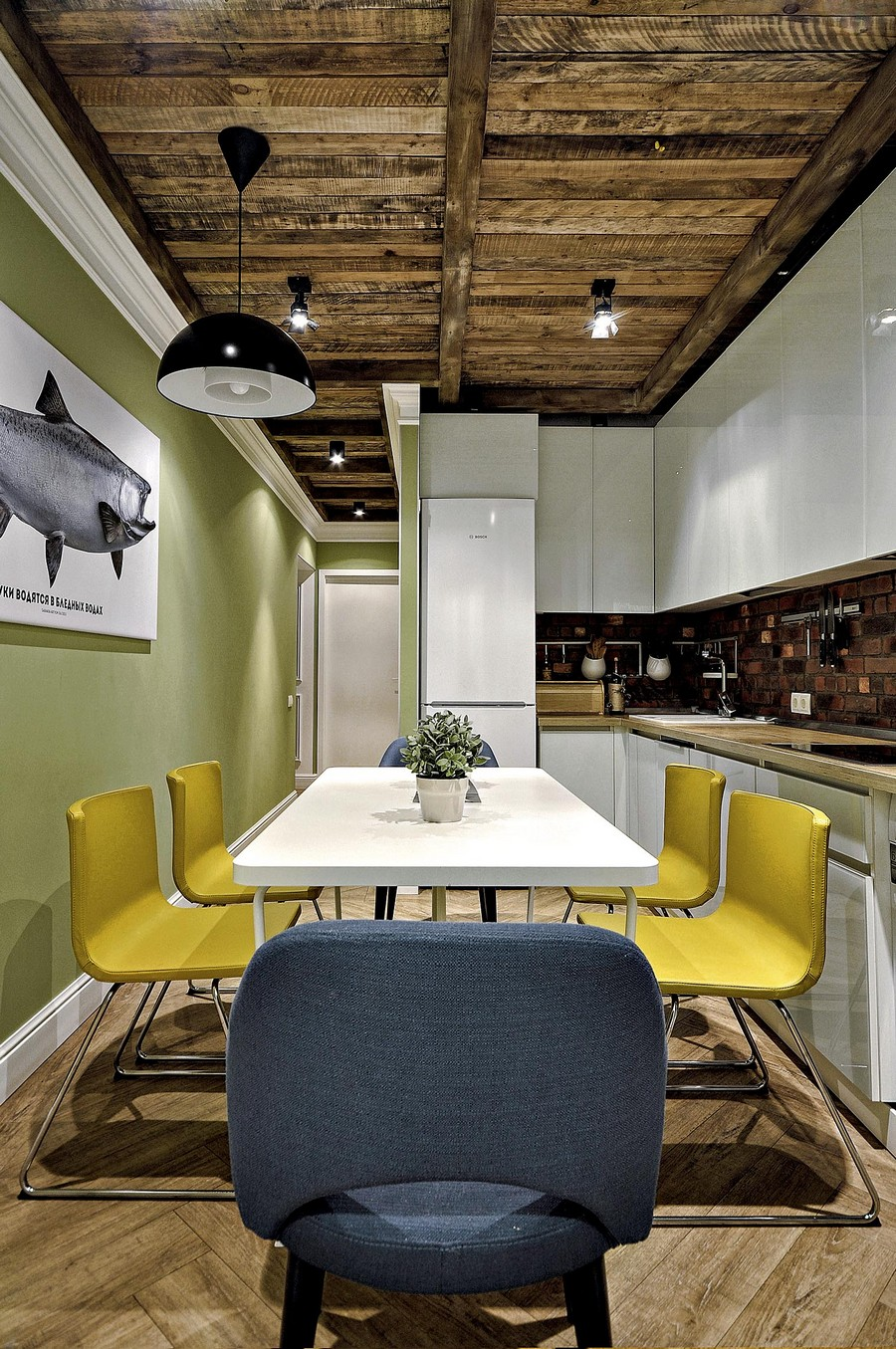 1-narrow-kitchen-interior-design-ideas-white-glossy-Scandinavian-style-handleless-cabinets-faux-brick-wall-tiles-backsplash-yellow-gray-dining-chairs-spot-lights-light-parquet-floor-herringbone-pattern-aged-wood-ceiling