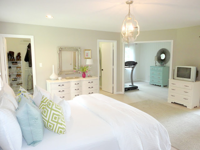 10-1-neo-classical-style-bedroom-interior-design-light-beige-walls-re-painted-white-furniture-upholstered-bed-curved-pale-blue-antique-chest-chest-of-drawers-rug-silver-mirror-TV-set-with-adjoining-home-gym-jogging