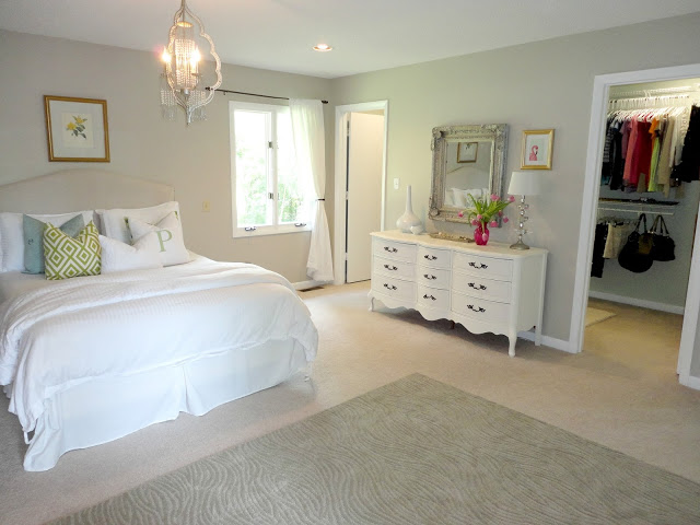 10-2-neo-classical-style-bedroom-interior-design-light-beige-walls-white-furniture-upholstered-bed-curved-chest-of-drawers-rug-walk-in-closet-lamp