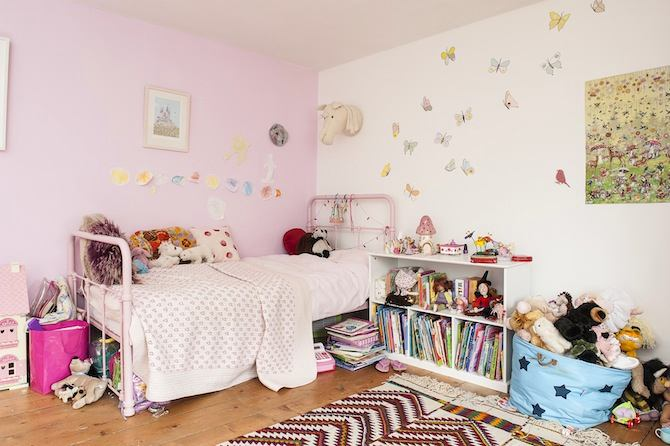 10-old-country-house-interior-design-vintage-style-pink-girl's-bedroom-room-iron-metal-bed-book-piles-much-stuff-cluttered
