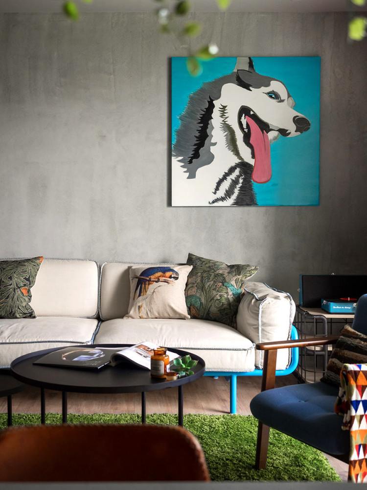 2-3-open-concept-living-room-interior-design-Taiwan-dog-artwork-blue-and-gray-sofa-metal-coffee-tables-arm-chair-throw-pillows-green-rug