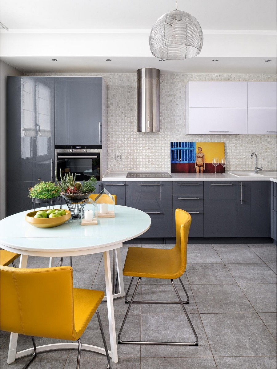 2-contemporary-style-interior-design-airy-light-bright-accents-kitchen-dining-room-mosaic-tiles-backsplash-gray-stainless-steel-cooker-hood-graphite-gray-glossy-cabinets-round-table-yellow-chairs