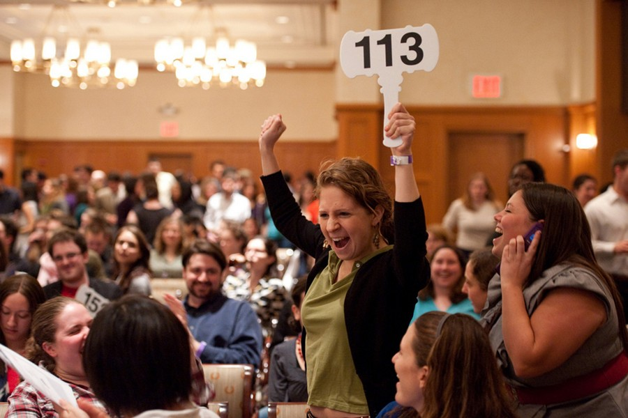 2-people-happy-woman-bought-won-a-bid-at-auction