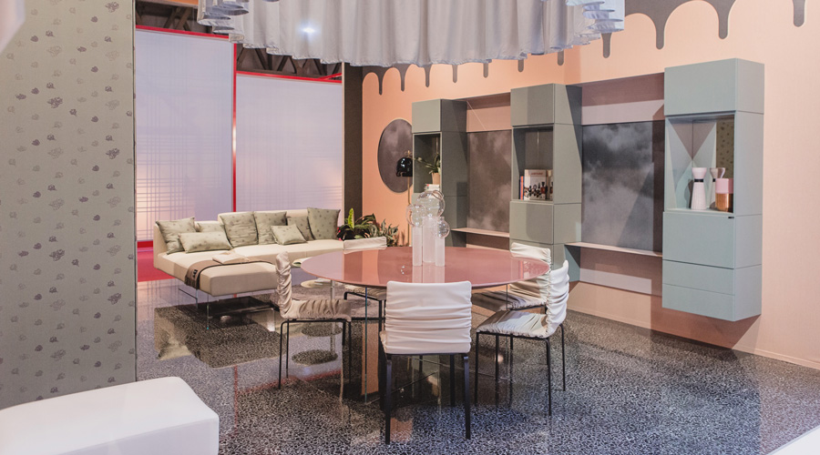 3-1-Lago-Italian-furniture-for-famous-women-Cristina-Celestino-open-concept-living-dining-room-pastel-pink-walls-white-sofa-gray-wall-mounted-cabinets-round-dining-table-chairs