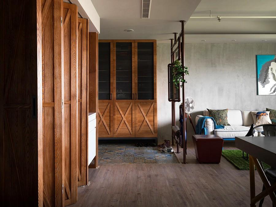 3-4-open-concept-living-room-entry-hallway-mudroom-metal-pipes-decor-wooden-folding-door