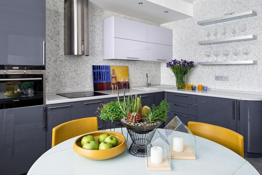 3-contemporary-style-interior-design-airy-light-bright-accents-kitchen-dining-room-mosaic-tiles-backsplash-gray-stainless-steel-cooker-hood-graphite-gray-glossy-cabinets-round-table-yellow-chairs