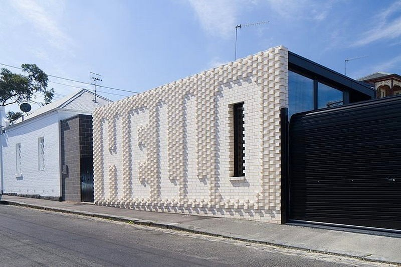 3-creative-small-house-in-Melbourne-suburbs-Australia-white-brick-exterior-wall-with-hello-word-narrow-tall-window-panoramic-windows-garage-entrance