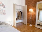 Historical Studio Apartment with Folk Motifs & Brick Wall