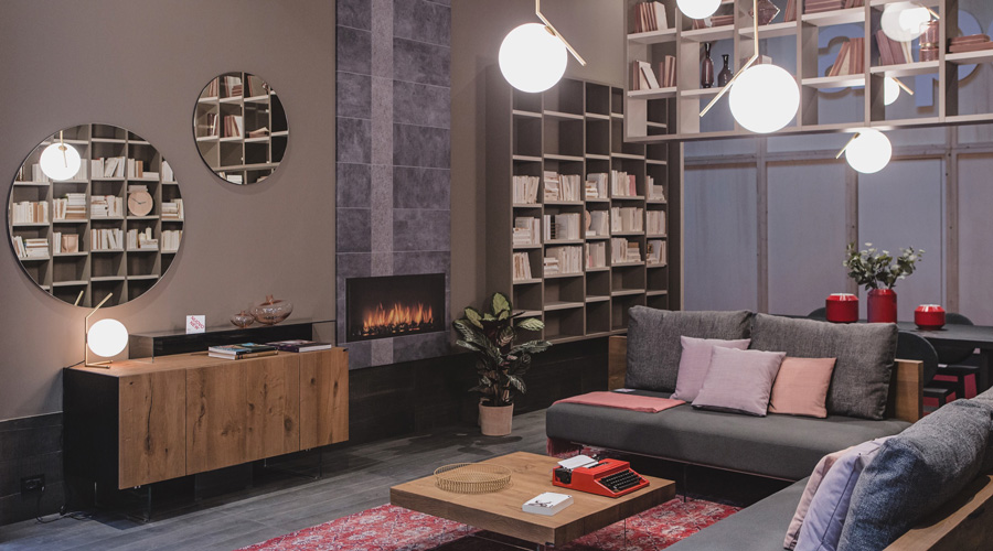 4-2-Lago-Italian-furniture-for-famous-women-Chiara-Gamberale-contemporary-style-living-room-interior-design-bookshelves-home-library-gray-corner-sofa-with-glass-base-legs-coffee-table-fireplace-round-mirrors