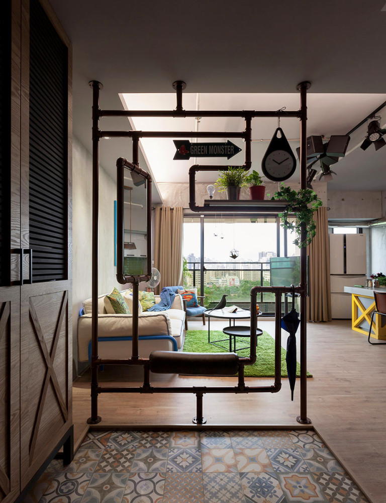 4-2-open-concept-living-room-entry-mudroom-interior-design-Taiwan-metal-pipes-decor-partition-in-loft-style-patchwork-floor-tiles-multifunctional-mirror-bench-plant-stand-clock-umbrella