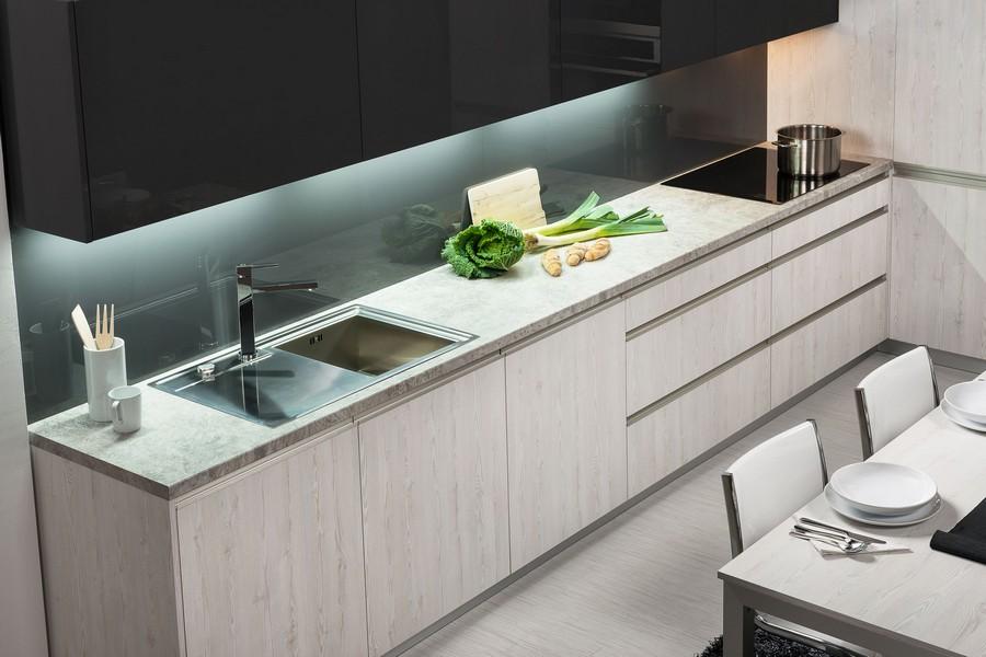 4-black-top-wall-kitchen-cabinets-gray-light-wood-base-cabinets-handleless-LED-lit-worktop-glossy-backsplash
