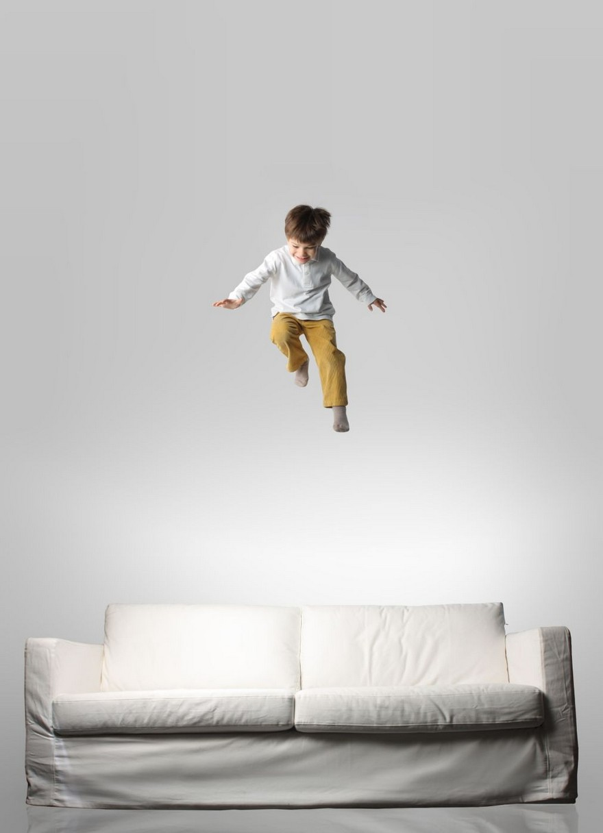 4-boy-kid-child-jumping-on-a-couch-sofa