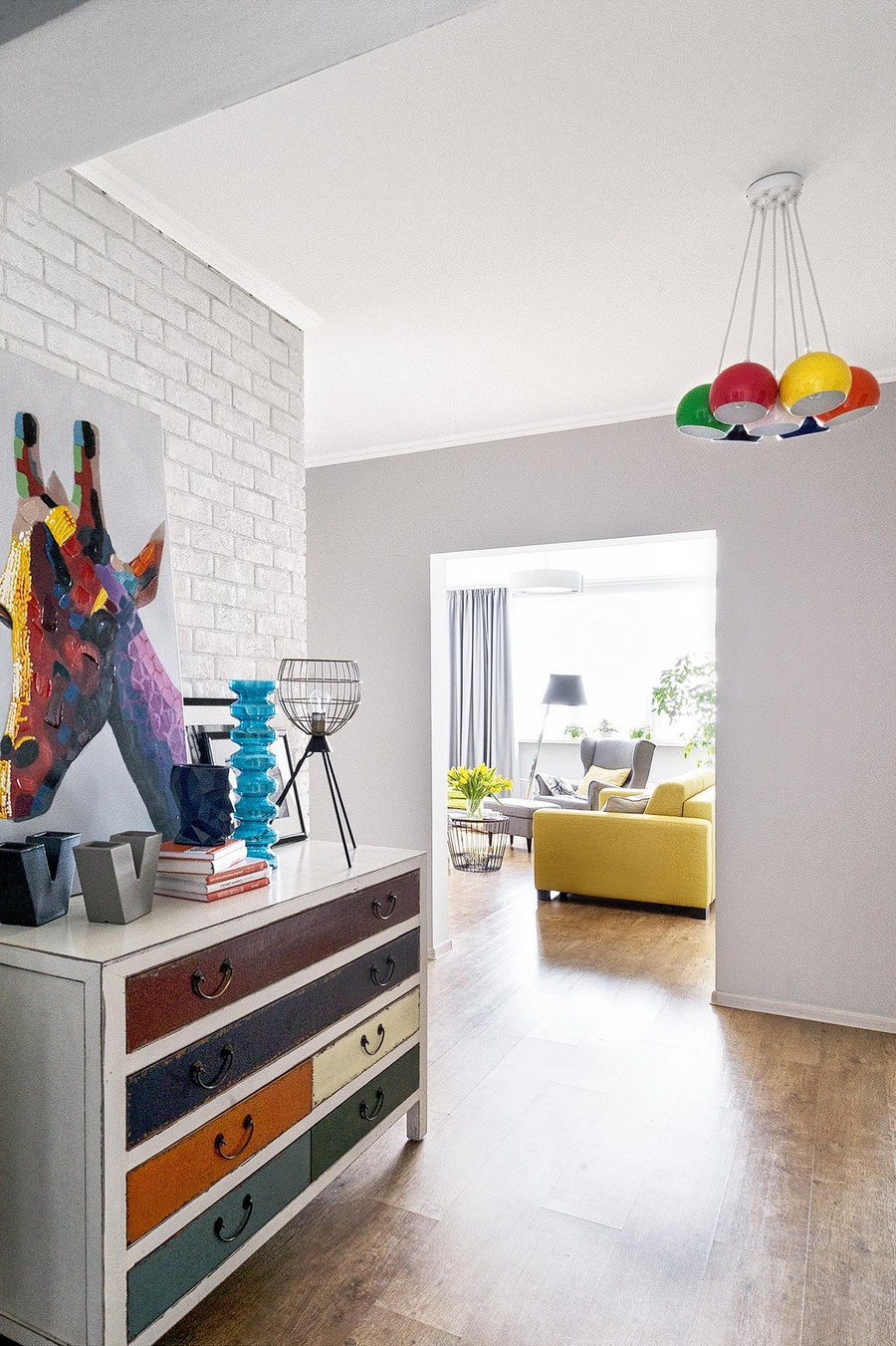 4-contemporary-style-interior-design-airy-light-bright-accents-corridor-hallway-scandinavian-style-motifs-faux-brick-white-wall-multicolor-chest-of-drawers-lamp-giraffe-artwork-modern-painting