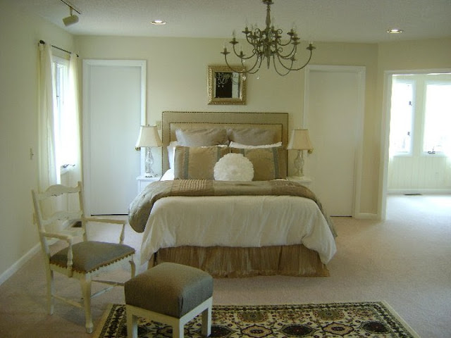 by trial error 10 versions of one bedroom interior 12090 | 4 neo classical style bedroom interior design light beige walls white doors upholstered bed with rivets chair ottoman rug adjoining room chandelier bedside ls symmetrical doors