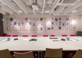 5-2-Mattel-office-interior-design-Russia-Moscow-toys-seller-meeting-room-narrow-long-elongated-space-white-faux-brick-walls-Barbie-wall-art-pictures-pink-chairs-exposed-ceiling-wires