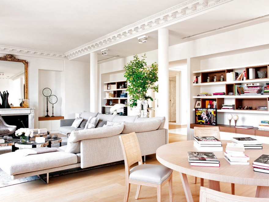 5-Paris-apartment-interior-design-contemporary-style-by-Stephane-Olivier-light-white-walls-pastel-colors-crown-moldings-columns-living-room-lounge-dining-table-corner-sofa-fireplace-luxurious-mirror-bookshelves
