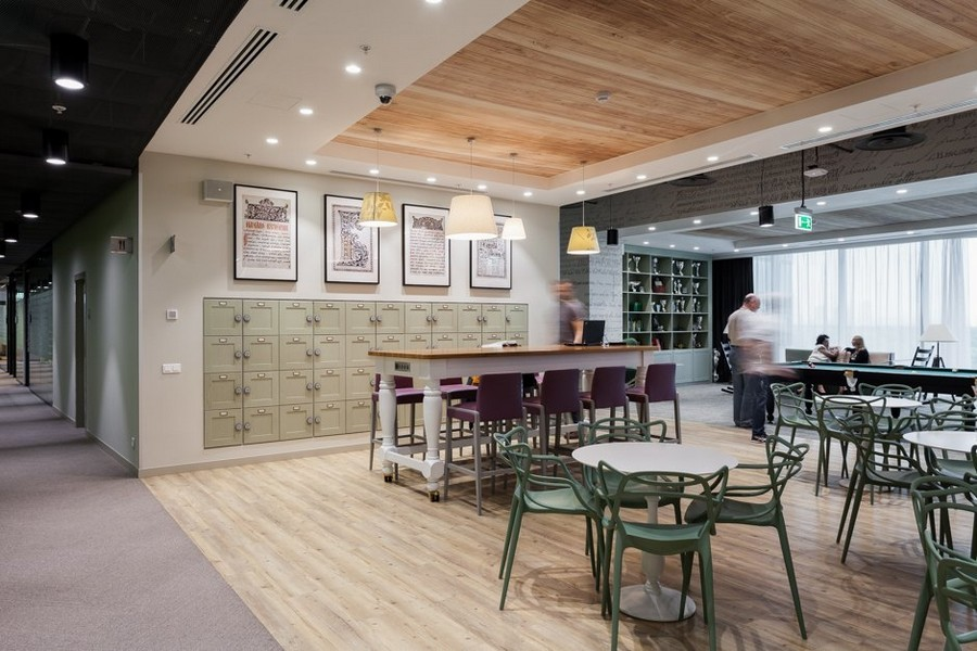 6-3-new-refreshed-renovated-Microsoft-office-headquarters-in-Moscow-interior-design-lounge-dining-zone-area-bar-table-stools-sofas-awards-wall