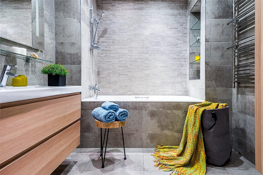 6-contemporary-style-interior-bathroom-design-gray-floor-wall-tiles-recessed-bathtuc-shelves-towel-drying-radiator-light-wood-vanity-unit-wall-mounted-wash-basin-cabinet-mustard-yellow-blanket-blue
