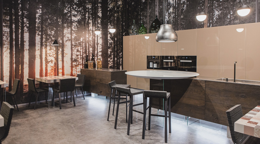 7-1-Lago-Italian-furniture-for-famous-women-Camilla-Lunelli-open-concept-kitchen-living-room-interior-design-beige-sleek-handleless-cabinets-glossy-island-dining-tables-forest-wood-wall-mural